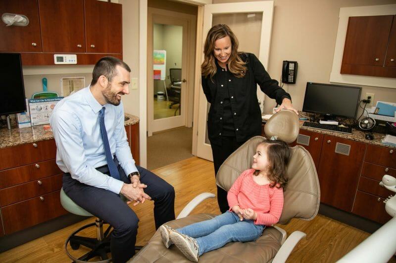 Green Dental examining child for dental sealants